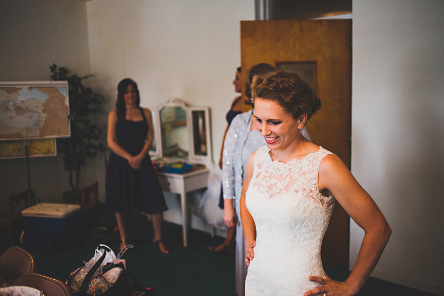 bride smiling after getting dressed