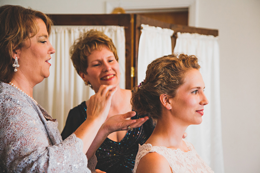 mother and aunt fixing brides hair