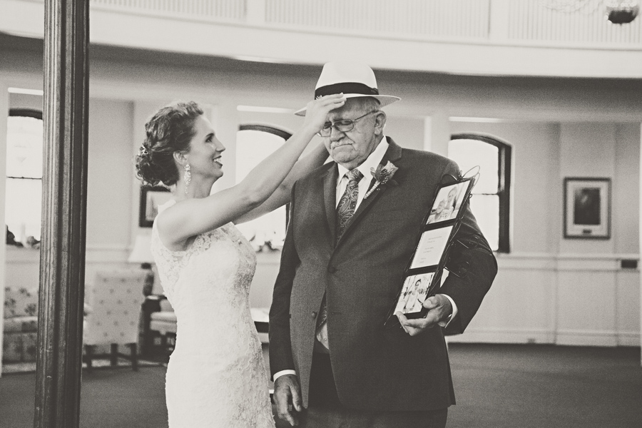 bride putting fathers hat on