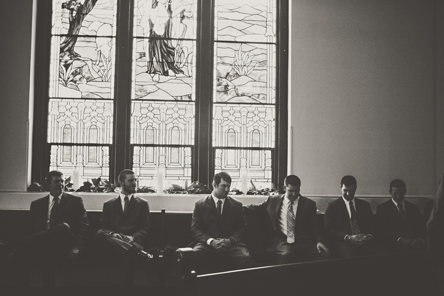 stained glass window and groomsmen
